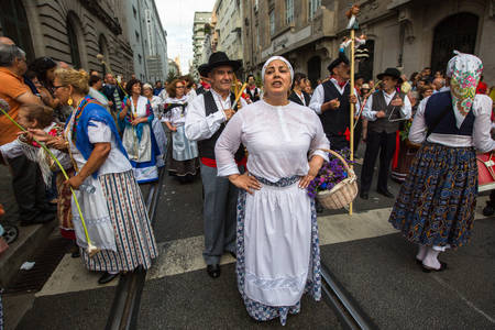 thousands: PORTO, PORTUGAL - JUN 25, 2017: Participants Festival of St John. Happens every year during Midsummer, thousands of people come to the city centre in a party that mixes sacred and profane traditions.