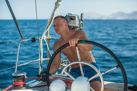 Yachtsman during in the race, sailing the Aegean sea.