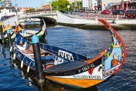 was: AVEIRO, PORTUGAL - JUN 30, 2017: Traditional boats moliceiro on main city canal. This vessels was originally used for harvesting of seagrass (molico), but currently most used for tourist purposes.