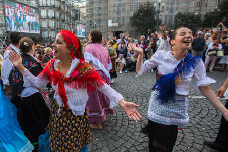 happens: PORTO, PORTUGAL - JUN 25, 2017: Participants Festival of St John. Happens every year during Midsummer, thousands of people come to the city centre in a party that mixes sacred and profane traditions.