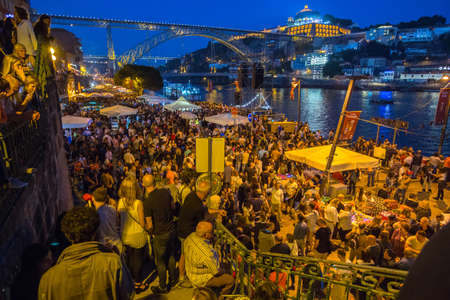 PORTO, PORTUGAL - JUN 24, 2017: Participants Sao Joao Festival (birth of St.John the Baptist) Very popular holiday is celebrated 23-24 June at midnight, next to the Douro River and Dom Luis I bridge. Editorial