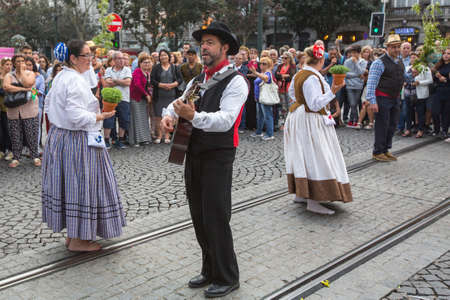 ethno: PORTO, PORTUGAL - JUN 25, 2017: Festival of St John (Festa de Sao Joao). Happens every year and has the status of the citys most important festival, yet it is relatively unknown outside the country.