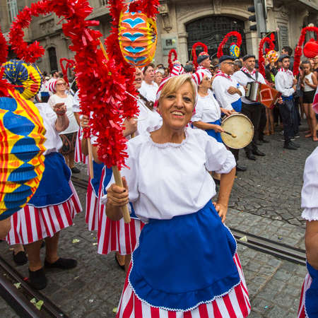 ethno: PORTO, PORTUGAL - JUN 25, 2017: Participants Festival of St John. Happens every year during Midsummer, thousands of people come to the city centre in a party that mixes sacred and profane traditions.