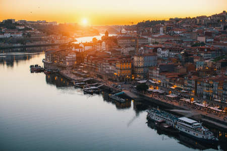 View of Ribeira on banks of Douro river during twilight, Porto, Portugal.