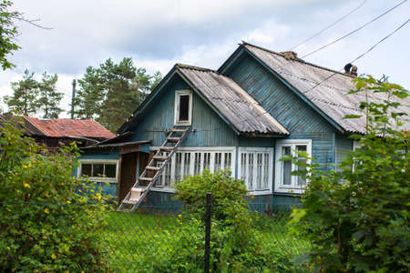 A typical residential wooden house in settlement in Leningrad region, Russia.