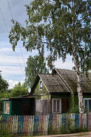 dilapidation: A typical residential wooden house in settlement in Leningrad region, Russia.