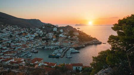 Views of Marina of the Hydra island in twilight. Aegean sea, Greece.
