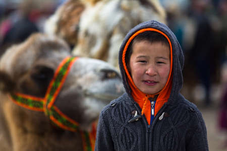 OLGIY, MONGOLIA - SEP 30, 2017: Unidentified Mongolian child during annual national competition with birds of prey Berkutchi of West Mongolia. Editorial