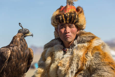 kyrgyzstan: OLGIY, MONGOLIA - SEP 30, 2017: Kazakh Golden Eagle Hunter at traditional clothing, during annual national competition with birds of prey Berkutchi of West Mongolia.