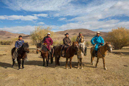 BAYAN-OLGII, MONGOLIA - SEP 28, 2017: Kazakh Eagle hunters on horseback. In Bayan-Olgii Province is populated to 88,7% by Kazakhs.