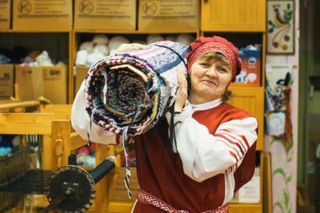 VAZHINY, LENINGRAD REGION, RUSSIA - DEC 21, 2017: Weaver in the Textile Studio of decorative art Tekstilnaya Plastika, at municipal budgetary institution of culture. Editorial