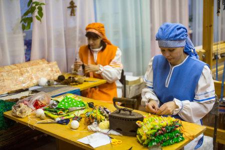 VAZHINY, LENINGRAD REGION, RUSSIA - DEC 21, 2017: Weaver while working in the Textile Studio of decorative art Tekstilnaya Plastika, at municipal budgetary institution of culture.