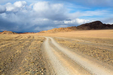 Road through the steppe and mountains of Western Mongolia.