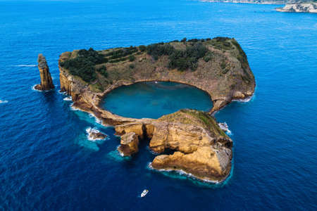 Top view of Islet of Vila Franca do Campo is formed by the crater of an old underwater volcano near San Miguel island, Azores, Portugal.