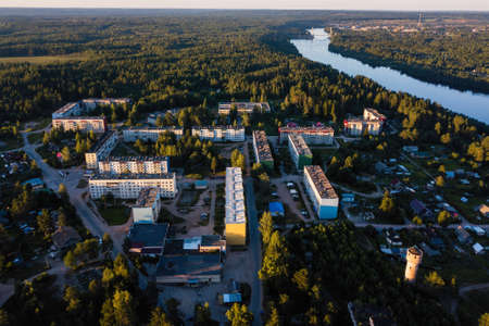 Aerial view of the urban village in the forests of Karelia. Nikolsky, Svir river, Leningrad region, Russia. Stock Photo