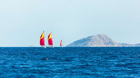 Luxury sailing boats participate in yacht regatta in the Aegean Sea in Greece.