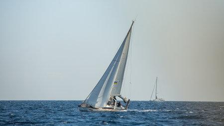 POROS - METHANA, GREECE - OCT 11, 2018: Sailors participate in sailing regatta 20th Ellada Autumn 2018 among Greek island group in the Aegean Sea, in Cyclades and Saronic Gulf.