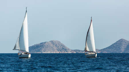 Sailing luxury boats participate in sail yacht regatta in the Aegean Sea in Greece. 写真素材