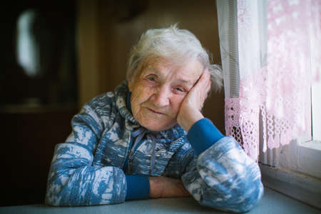 Portrait of russian elderly woman close-up. Age 90 years old.