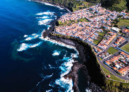 Top view the ocean surf on reefs coast of San Miguel island, Azores - Portugal.