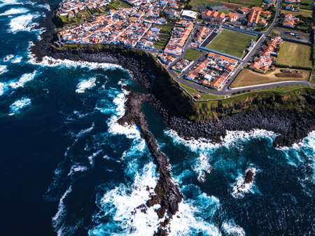 Top view of the ocean surf on the reefs coast San Miguel island - Azores, Portugal.