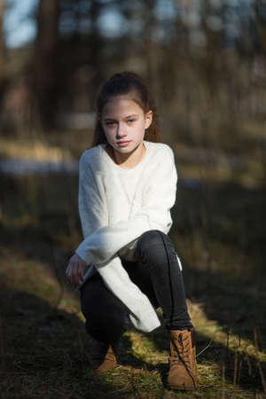 Twelve year old cute girl portrait outdoors.