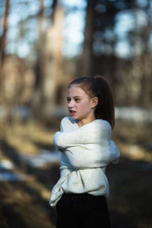 Cute twelve year old girl in the park posing for the camera. Imagens