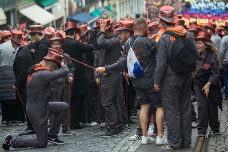 PORTO, PORTUGAL - MAY 7, 2019: During Cortejo Queima das Fitas - annual festivity of Portuguese students of universities. The graduates wear a top-hat and a walking-cane, both colour of their Faculty.