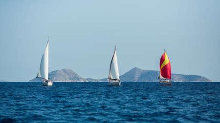 Sailing yacht boats at the Aegean Sea. Sailboats Regatta.