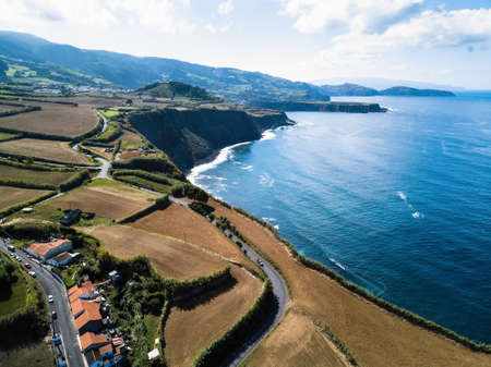 View of the ocean surf on the reefs coast of San Miguel island, Azore - Portugal. Stock Photo