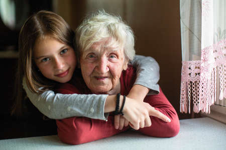 Portraits of the little girl and her old grandmother.