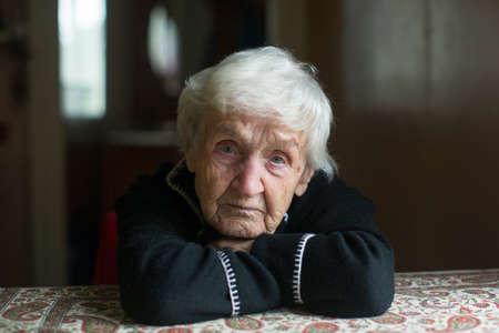 Close-up portrait of an elderly meloncholic pensioner woman.