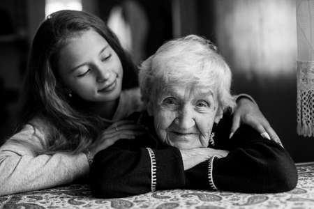 Happy granny and little girl. Black and white photo.