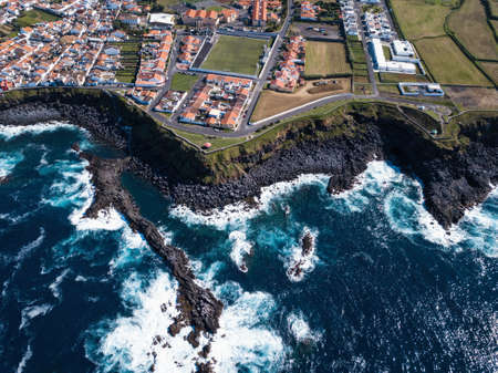 Flying over the ocean surf on the coast of San Miguel island, Azores, Portugal. 写真素材