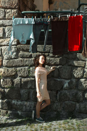 Mixed-race woman posing in old Porto downtown, Portugal.
