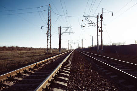 Railway tracks and electric lines in the industrial zone.
