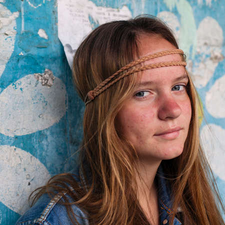 Close-up portrait of young cool girl hippie outdoor (Woodstock concept)