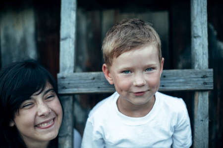 Portrait of small funny boy with sister, close-up. The village children outdoors. Stockfoto