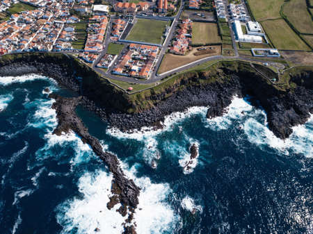 Top view of the ocean surf on the reefs coast – San Miguel island, Azores, Portugal.