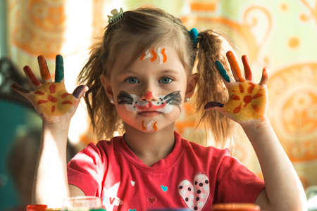 Portrait of little cute girl with paint of face. Stockfoto