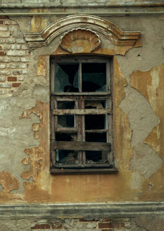 Abandoned. A window in an old ruined house.