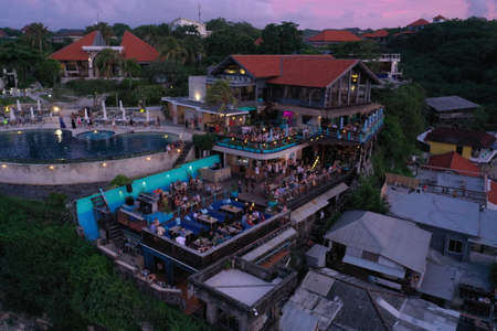 Aerial photo of swimming pool and cafe with people in Uluwatu, Bali, Indonesia 写真素材 - 122433447