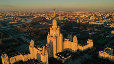 Stalin's skyscraper from drone, Moscow University on sunset in spring. Moscow river. Russia. Aerial view. Bird's view point.