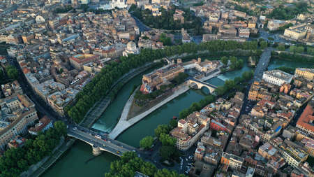 Aerial footage of Tiberina island in Tiber river, Rome, Italy. From drone. Bird?s eye view. Sunny day.