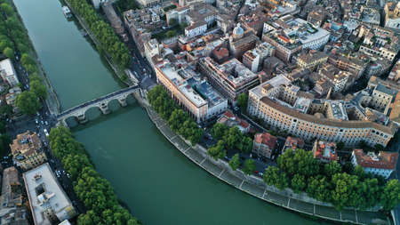 Aerial footage of the Tiber River and center of Rome, Italy. Coliseum. Ancient capital. From drone. 写真素材