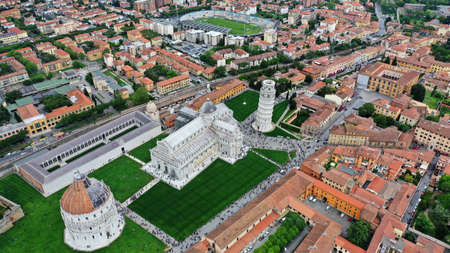 Aerial image of the Square of Miracles with Pisa's Leaning Tower, Cathedral of Santa Maria Assunta and Baptistery in Pisa, Tuscany, Italy.