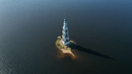 Kalyazin flooded Bell Tower from drone. Aerial view of Kalyazin, Russia. Russian orthodox architecture on the Volga River. Ð¡hurch in the middle of the river