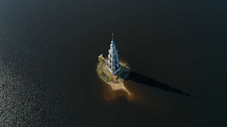 Kalyazin flooded Bell Tower from drone. Aerial view of Kalyazin, Russia. Russian orthodox architecture on the Volga River. Сhurch in the middle of the river 写真素材