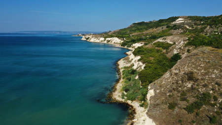 Aerial view of Thracian Cliffs near clear blue water of Black sea, Cape Kaliakra, Bulgaria. Sunny day. Blue sky. Travel wallpaper.
