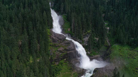 Aerial view of Krimml waterfall, cascades. Landscape with spruces, fir tree forest, stones, water flowing from mountains. Salzburg land, Austria. Imagens